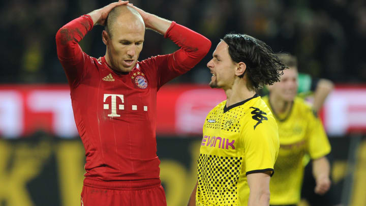 Dortmund's Neven Subotić letting Robben know what he thought of the penalty miss