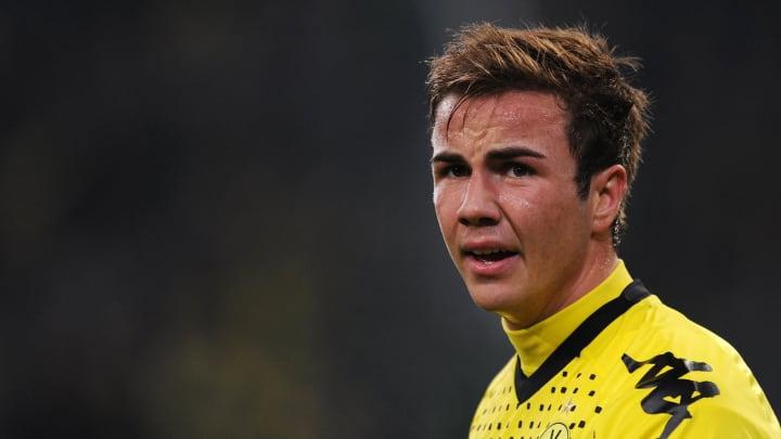 Dortmund's midfielder Mario Goetze react