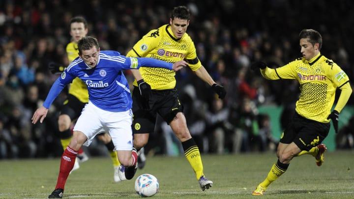 Dortmund's midfielder Sebastian Kehl (C)