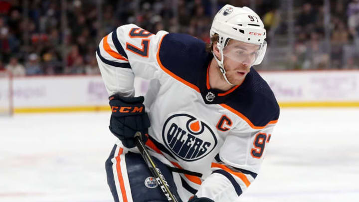 DENVER, COLORADO - NOVEMBER 27: Connor McDavid #97 of the Edmonton Oilers advances the puck against the Colorado Avalanche in the first period at the Pepsi Center on November 27, 2019 in Denver, Colorado. (Photo by Matthew Stockman/Getty Images)