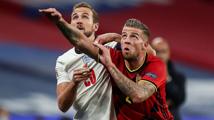 Harry Kane tussles with Toby Alderweireld