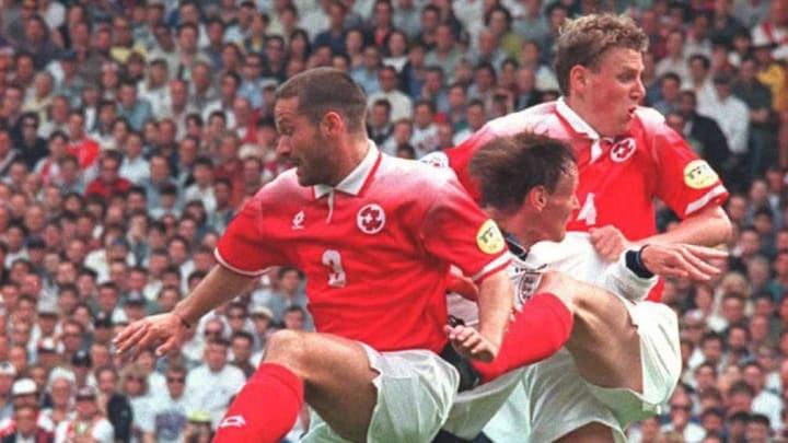 England's Steve McManaman is caught between Switze