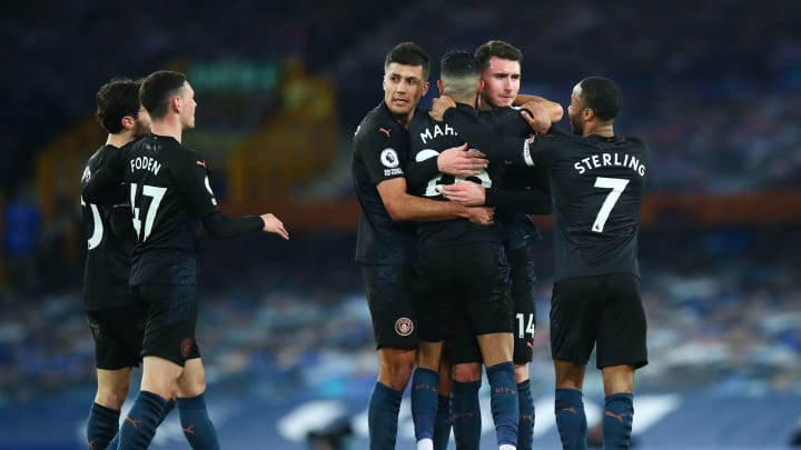 Manchester City players celebrate going 2-1 up against Everton