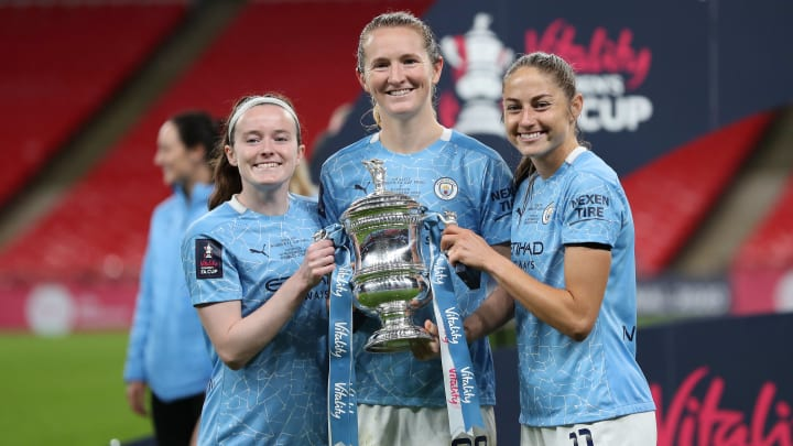 Rose Lavelle (L) & Sam Mewis (C) have left Man City after one season in the WSL