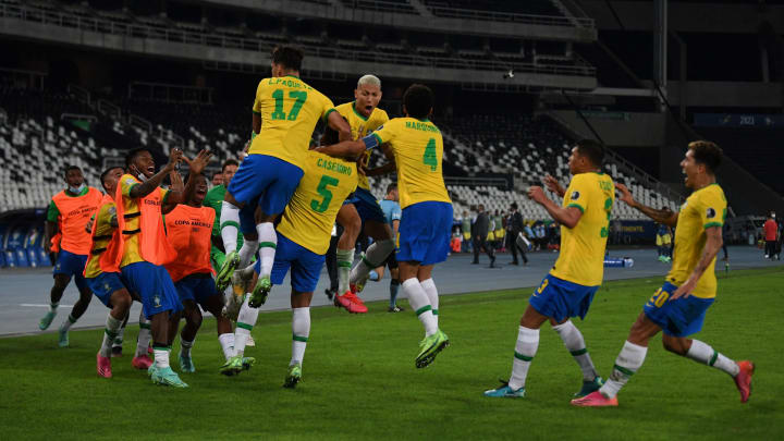 Brazil celebrating a goal against Colombia