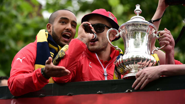 Wilshere entertained the masses about Arsenal's trophy parade bus