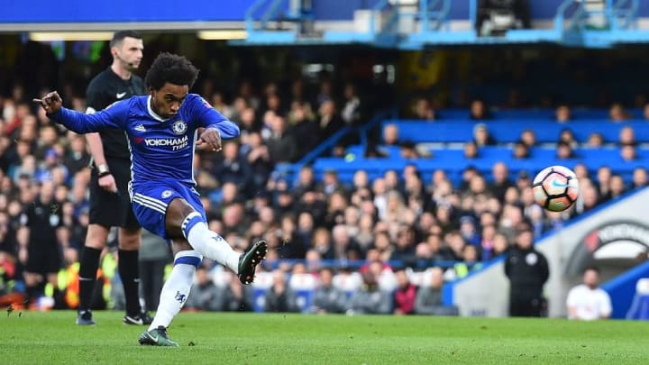 Willian attempts a free-kick for Chelsea