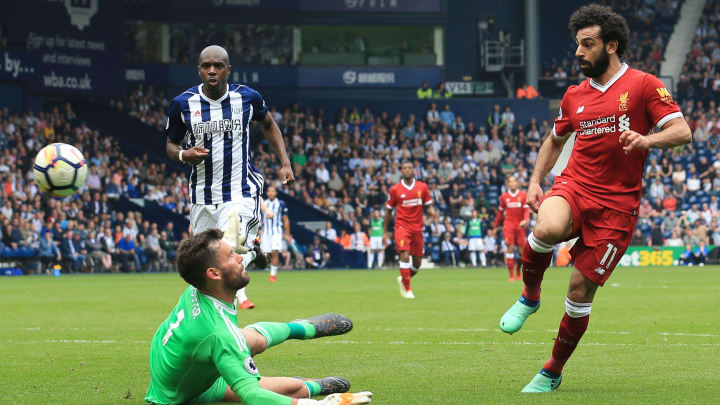 Salah chips the ball over West Brom keeper for Liverpool
