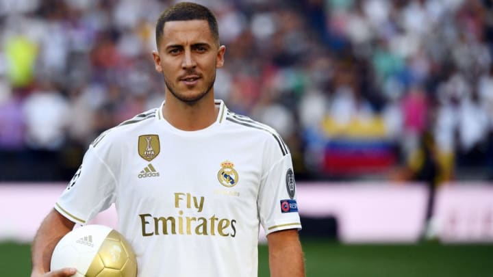 Belgian footballer Eden Hazard poses during his official presentation as new player of the Real Madrid CF at the Santiago Bernabeu stadium in Madrid on June 13, 2019. (Photo by GABRIEL BOUYS / AFP)        (Photo credit should read GABRIEL BOUYS/AFP/Getty Images)