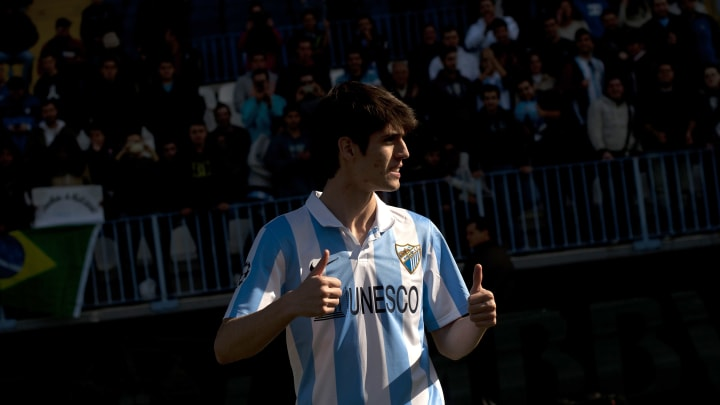 Lucas Piazon goes for the double thumbs up during his presentation for Malaga, the first of seven different loan spells