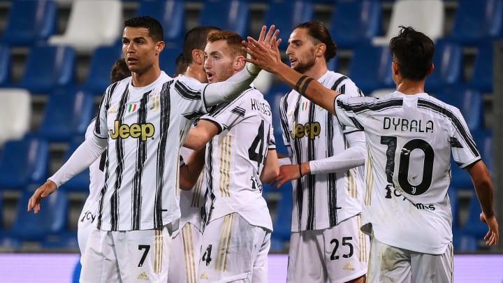 The Juventus side celebrate Rabiot's opener