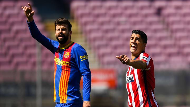 Gerard Pique dan Luis Suarez