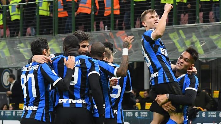Inter players celebrating Nicolo Barella's winner in the Coppa Italia quarter-final against Fiorentina