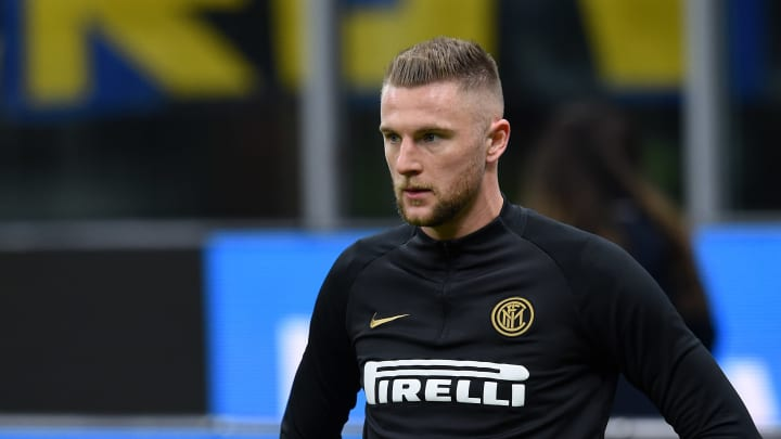 Milan Skriniar warming up before Inter's clash with Genoa.
