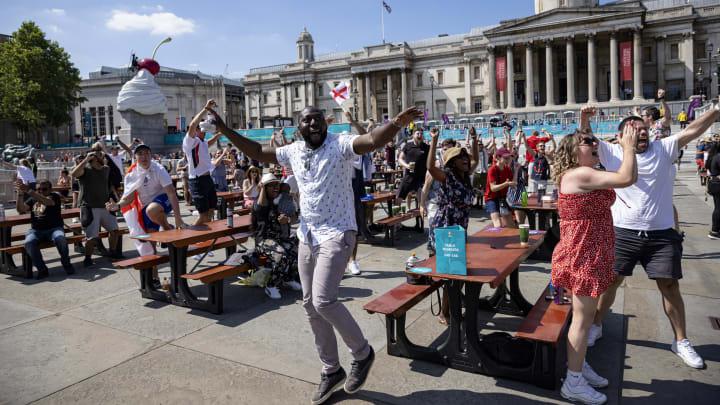 England fans celebrate at the Trafalgar Square fan park in London