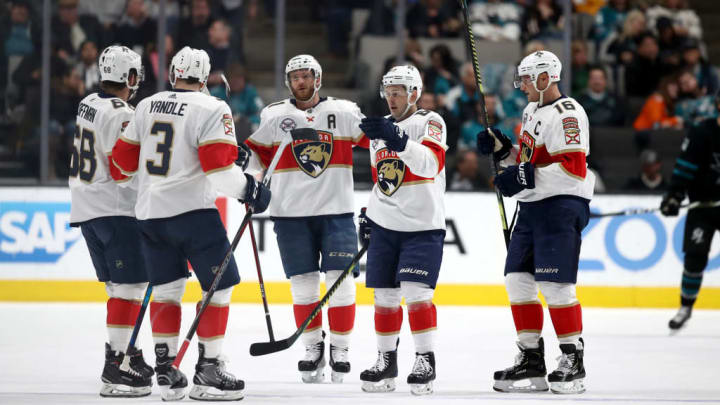 SAN JOSE, CALIFORNIA - MARCH 14:  Mike Hoffman #68 of the Florida Panthers is congratulated by teammates after scoring a goal against the San Jose Sharks at SAP Center on March 14, 2019 in San Jose, California. (Photo by Ezra Shaw/Getty Images)