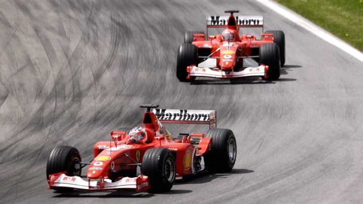 SPIELBERG, AUSTRIA - MAY 12:  GP von Oesterreich 2002, Spielberg; Rubens BARRICHELLO/BRA vor Michael SCHUMACHER/GER - Ferrari -  (Photo by Christof Koepsel/Bongarts/Getty Images)
