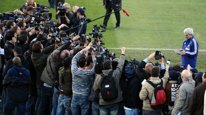 France's coach Raymond Domenech (R) spea