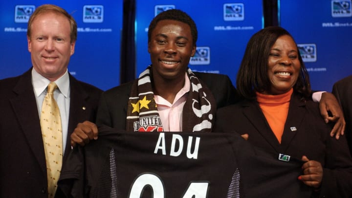 Freddy Adu (centre) after signing for DC United.