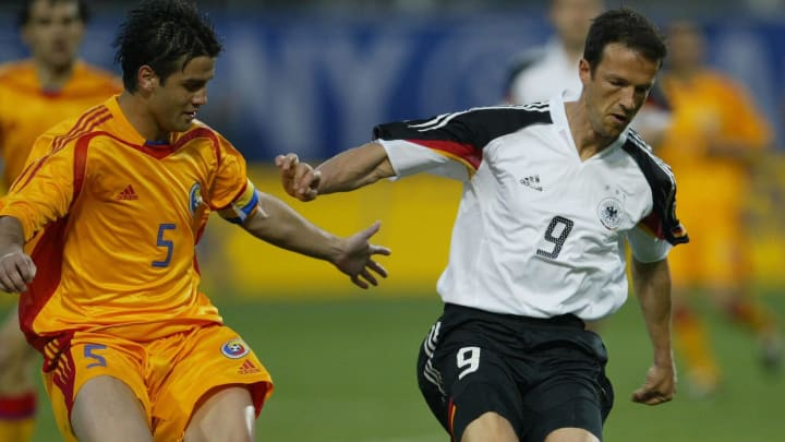 Fredi Bobic (R) from Germany fights for