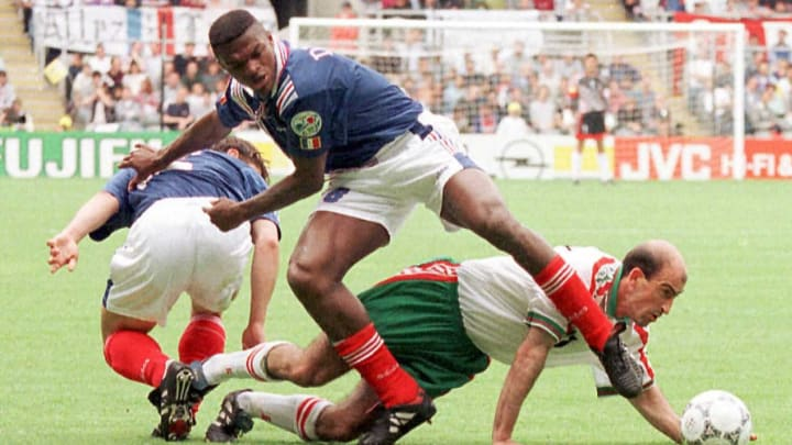 French Marcel Desailly fights for the ball with Bu