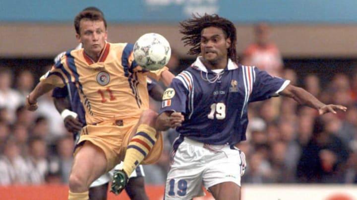 French defender Christian Karembeu(R) battles with