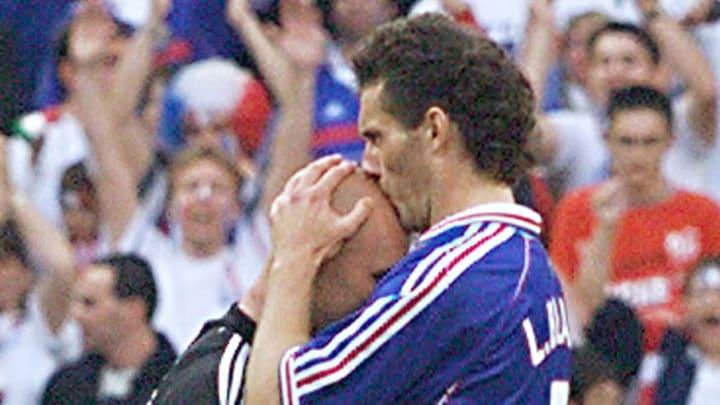 French defender Laurent Blanc kisses the