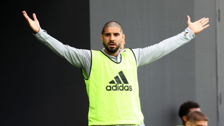 Mitrovic was on the bench for the opening league game