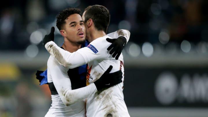 Henrikh Mkhitaryan embraces Justin Kluivert