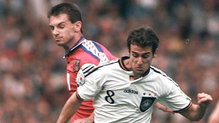 German Mehmet Scholl (R) fights for the ball with