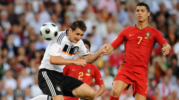 German forward Miroslav Klose (L) jumps