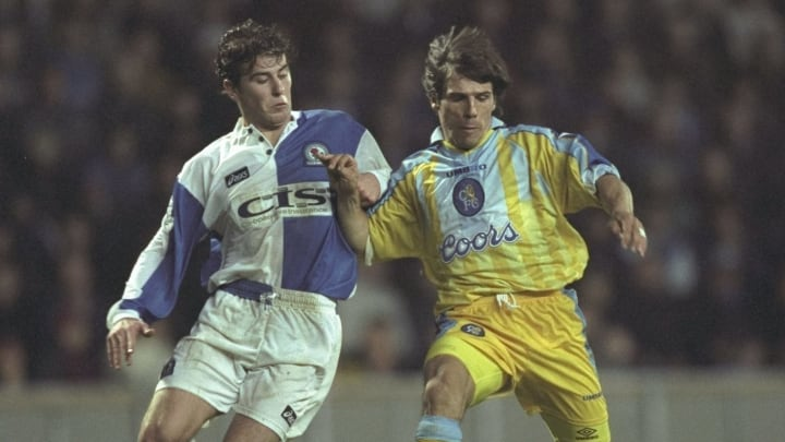 Gianfranco Zola of Chelsea (left) gets to the ball ahead of Gary Croft of Blackburn