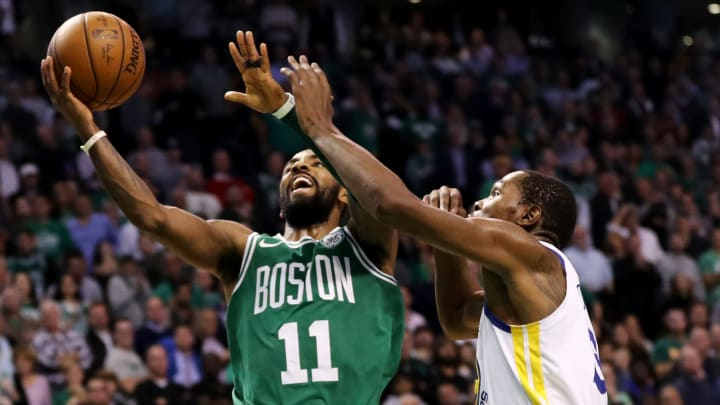 BOSTON, MA - NOVEMBER 16: Kyrie Irving #11 of the Boston Celtics takes a shot against Kevin Durant #35 of the Golden State Warriors during the fourth quarter at TD Garden on November 16, 2017 in Boston, Massachusetts. The Celtics defeat the Warriors 92-88. (Photo by Maddie Meyer/Getty Images)