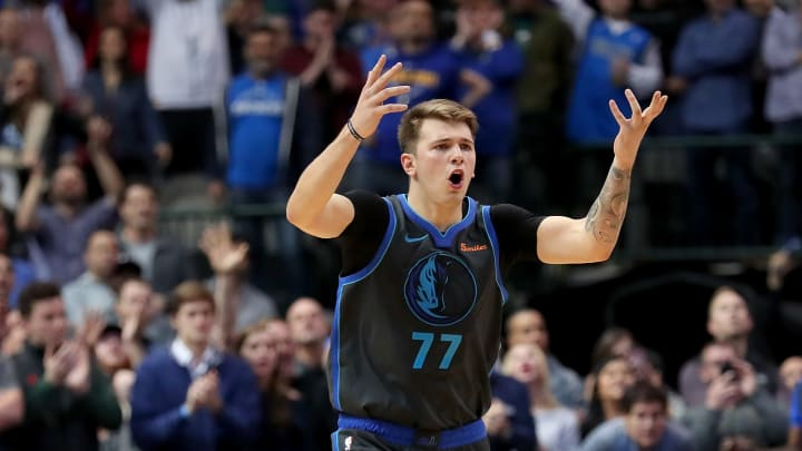 DALLAS, TX - NOVEMBER 17:  Luka Doncic #77 of the Dallas Mavericks reacts in the final seconds of the game as the Dallas Mavericks beat the Golden State Warriors 112-109 at American Airlines Center on November 17, 2018 in Dallas, Texas. NOTE TO USER: User expressly acknowledges and agrees that, by downloading and or using this photograph, User is consenting to the terms and conditions of the Getty Images License Agreement.  (Photo by Tom Pennington/Getty Images)