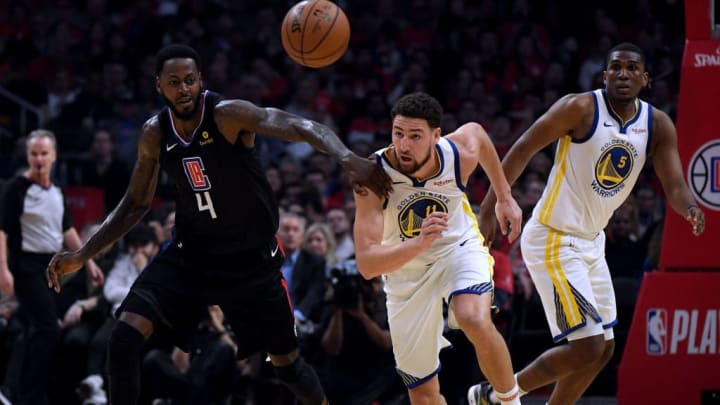 LOS ANGELES, CALIFORNIA - APRIL 26:  Klay Thompson #11 of the Golden State Warriors steals the ball from JaMychal Green #4 of the LA Clippers in the first half during Game Six of Round One of the 2019 NBA Playoffs at Staples Center on April 26, 2019 in Los Angeles, California. (Photo by Harry How/Getty Images)  NOTE TO USER: User expressly acknowledges and agrees that, by downloading and or using this photograph, User is consenting to the terms and conditions of the Getty Images License Agreement.