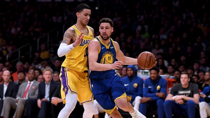 LOS ANGELES, CALIFORNIA - JANUARY 21:  Klay Thompson #11 of the Golden State Warriors drives on Kyle Kuzma #0 of the Los Angeles Lakers during a 130-111 Warriors win at Staples Center on January 21, 2019 in Los Angeles, California.  NOTE TO USER: User expressly acknowledges and agrees that, by downloading and or using this photograph, User is consenting to the terms and conditions of the Getty Images License Agreement. (Photo by Harry How/Getty Images)