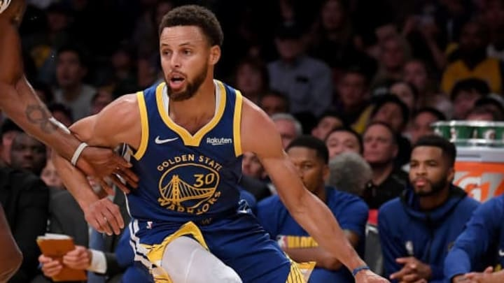 LOS ANGELES, CALIFORNIA - OCTOBER 14:  Stephen Curry #30 of the Golden State Warriors dribbles in front of Dwight Howard #39 of the Los Angeles Lakers during the first half at Staples Center on October 14, 2019 in Los Angeles, California. (Photo by Harry How/Getty Images)