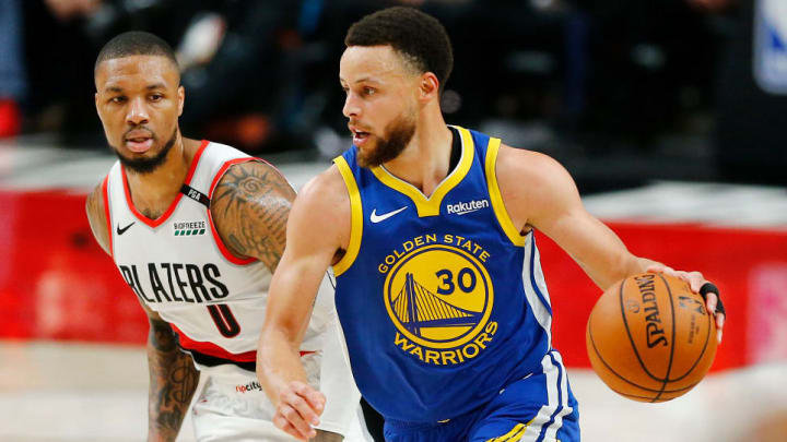PORTLAND, OREGON - MAY 18: Stephen Curry #30 of the Golden State Warriors dribbles against Damian Lillard #0 of the Portland Trail Blazers during the second half in game three of the NBA Western Conference Finals at Moda Center on May 18, 2019 in Portland, Oregon. NOTE TO USER: User expressly acknowledges and agrees that, by downloading and or using this photograph, User is consenting to the terms and conditions of the Getty Images License Agreement. (Photo by Jonathan Ferrey/Getty Images)