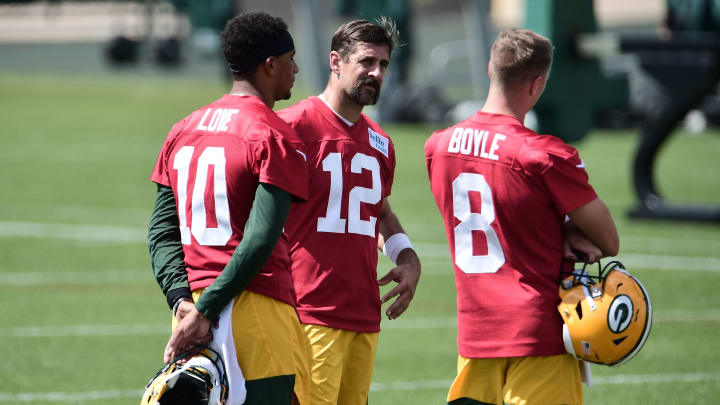 Green Bay Packers quarterbacks hanging out.