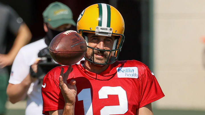 Aaron Rodgers spinning a football.