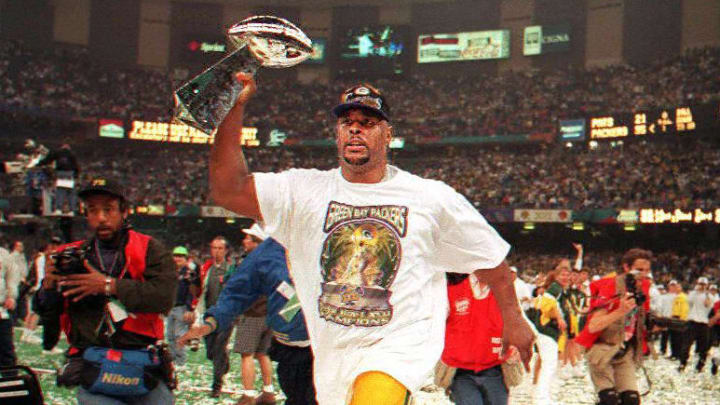 Green Bay Packers defensive tackle Reggie White celebrates the Super Bowl XXXI win.