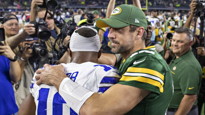 ARLINGTON, TX - OCTOBER 6:  Aaron Rodgers #12 of the Green Bay Packers hugs Randall Cobb #18 of the Dallas Cowboys at AT&T Stadium on October 6, 2019 in Arlington, Texas.  The Packers defeated the Cowboys 34-24.  (Photo by Wesley Hitt/Getty Images)