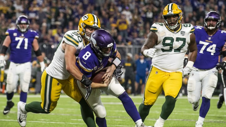 MINNEAPOLIS, MN - NOVEMBER 25:  Kirk Cousins #8 of the Minnesota Vikings is tackled with the ball by Blake Martinez #50 of the Green Bay Packers third quarter of the game at U.S. Bank Stadium on November 25, 2018 in Minneapolis, Minnesota. (Photo by Stephen Maturen/Getty Images)
