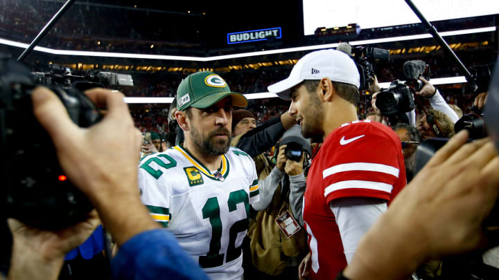 Aaron Rodgers and Jimmy Garoppolo meet post-game following San Francisco's Week 12 win.