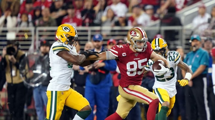 SANTA CLARA, CALIFORNIA - NOVEMBER 24:  Tight end George Kittle #85 of the San Francisco 49ers carries the ball after making a catch as cornerback Jaire Alexander #23 of the Green Bay Packers defends during the first half of the game at Levi's Stadium on November 24, 2019 in Santa Clara, California. (Photo by Thearon W. Henderson/Getty Images)