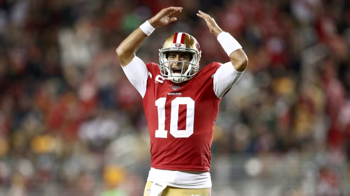 SANTA CLARA, CALIFORNIA - NOVEMBER 24:  Jimmy Garoppolo #10 of the San Francisco 49ers celebrates after Raheem Mostert #31 ran in for a touchdown in the fourth quarter against the Green Bay Packers at Levi's Stadium on November 24, 2019 in Santa Clara, California. (Photo by Ezra Shaw/Getty Images)