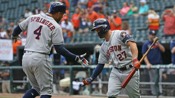 CHICAGO, ILLINOIS - AUGUST 13: George Springer #4 of the Houston Astros is greeted by Jose Altuve #27 after hitting a first pitch, lead-off home run in the 1st inning against the Chicago White Sox at Guaranteed Rate Field on August 13, 2019 in Chicago, Illinois. (Photo by Jonathan Daniel/Getty Images)