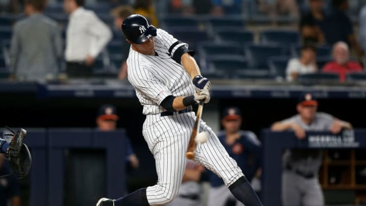 NEW YORK, NEW YORK - JUNE 20:   DJ LeMahieu #26 of the New York Yankees connects on his fourth inning two run home run against the Houston Astros at Yankee Stadium on June 20, 2019 in the Bronx borough of New York City. (Photo by Jim McIsaac/Getty Images)