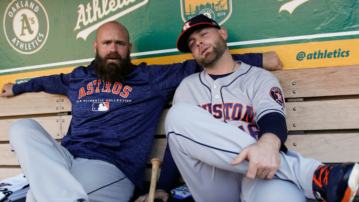 OAKLAND, CA - MAY 7: Evan Gattis #11 and Brian McCann #16 of the Houston Astros relax in the dugout prior to the game against the Oakland Athletics at the Oakland Alameda Coliseum on May 7, 2018 in Oakland, California. The Astros defeated the Athletics 16-2. (Photo by Michael Zagaris/Oakland Athletics/Getty Images)  *** Local Caption *** Evan Gattis;Brian McCann