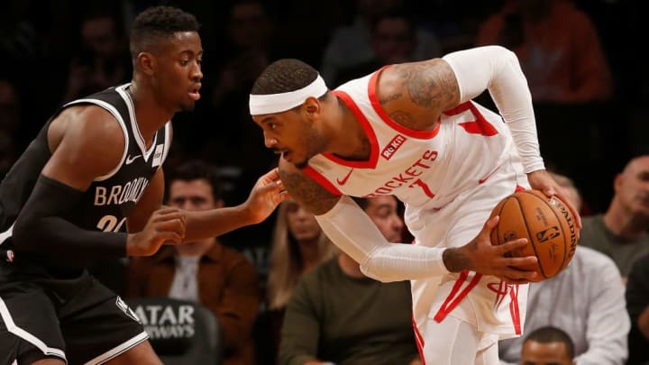 BROOKLYN, NY - NOVEMBER 02:  (NEW YORK DAILIES OUT)    Carmelo Anthony #7 of the Houston Rockets in action against Caris LeVert #22 of the Brooklyn Nets at Barclays Center on November 2, 2018 in the Brooklyn borough of New York City.  The Rockets defeated the Nets 119-111. NOTE TO USER: User expressly acknowledges and agrees that, by downloading and/or using this photograph, user is consenting to the terms and conditions of the Getty Images License Agreement.  (Photo by Jim McIsaac/Getty Images)